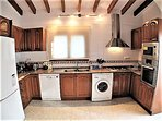 Kitchen with fridge freezer, dish washer, washing machine, oven, microwave and 5 ring gas hob.