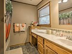 The en-suite bathroom features a shower/tub combo and ample counter space.