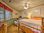 This bedroom with a queen and twin bed is great for small families.