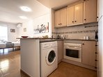 Kitchen fitted with washing machine, oven, hob and all utensils needed for a self catering holiday.