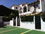 The house is in a secure, small, gated community with a parking space directly outside.