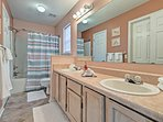 You'll find a double vanity in this en-suite bathroom.