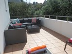 Large private terrace off bedroom two with sun loungers and seating area
