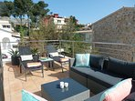 Large terrace facing the Tramuntana Cliffs and overlooking the pool