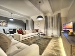 Overview - modern and spacious living area with dining seating for 6 people