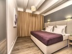 Master bedroom with king-sized double bed
