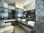 Master bathroom with bathtub as well as shower corner