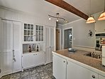 The kitchen offers new appliances and plenty of counter space.