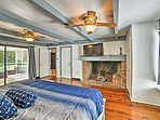 The master bedroom hosts a king bed.