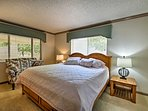 The second bedroom has a cozy queen bed.
