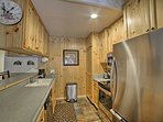 Stainless steel appliances highlight the fully equipped kitchen.