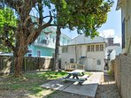Private back yard: 2 oak trees, picnic table, charcoal grill.