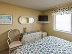 Enjoy TV in the master bedroom king size bed.  Beds will be made when you arrive.