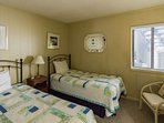 The second bedroom has two twin beds, along with a second full bathroom.