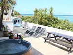 Beach Bungalow Patio with Private Hot Tub overlooking the Beach with iconic Sea Views