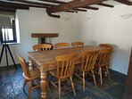 Dining area adjacent to kitchen allows Cooks to socialise with diners. Wood burner & exposed beams