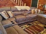 sectional sofa with all reclining seats, facing the fireplace
