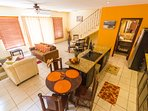 Fully equipped kitchen with dining and breakfast tables