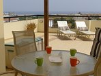 Both shade and sun on the exceptional, large veranda. 4 x comfy sun loungers and extensive sea views
