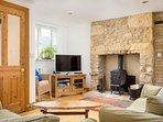 The light and spacious living room, with a Jotul log burner