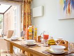The sociable dining table can seat 10 guests