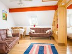 The living room in the Bolt Hole contains two single sofa beds