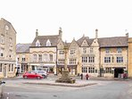 Stow's ancient stone cross, in the picturesque market square