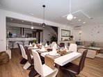 Fully equipped kitchen with dining and living area, with exit to pool area with outdoor dining