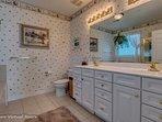 Master bath has dual vanity , soaking tub, separate shower and Crystal Chandelier.