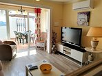 Large tv, air con in Lounge
