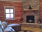 living room with stone gas fireplace