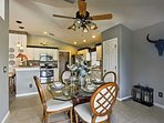 Dine in style at this 4-seat dining table with lavish embellishments.