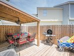 Patio with table and chairs, 1 charcoal BBQ and 1 electric BBQ, beach wagon, etc