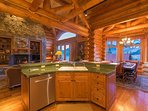 A kitchen island has views into both the living area and the dining room.