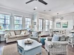 There's plenty of seating in the living room for the family to relax and watch TV on a rainy day.