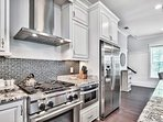 Cook up a delicious meal in the spacious kitchen with stainless steel appliances.