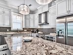 The kitchen features stainless steel appliances and gorgeous countertops.