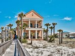 This home features a private walkway down to the beach.