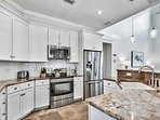 Granite countertops and stainless appliances make for a beautifully modern kitchen.