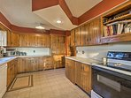 The kitchen has plenty of cabinets so you can store your cooking supplies.
