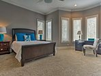 This spacious bedroom boasts a large queen bed.
