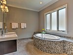 This master suite is complete with a soaking tub.