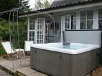 The private hot tub is one step away from the conservatory french doors.