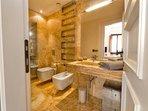 Golden travertine spa bathroom