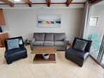 High quality furniture. New sleeper sofa and leather chairs.