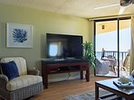 HDTV4 with glider chair and view of balcony & sea