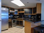 Kitchen with stainless, granite, under cabinet lighting