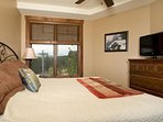The bedrooms feature large windows with beautiful views
