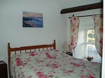 Master front bedroom overlooking the estuary with one double bed