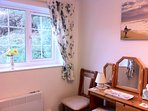 Rear bedroom overlooking the hillside which is a beautiful yellow when the gorse is in flower